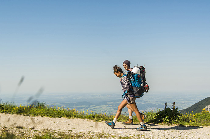 Photo, using the rule of thirds, of a man and woman hiking on a path