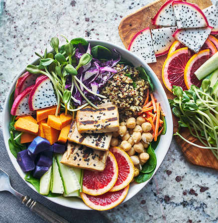 Colourful food image of a grilled tofu salad with dragonfruit and blood oranges