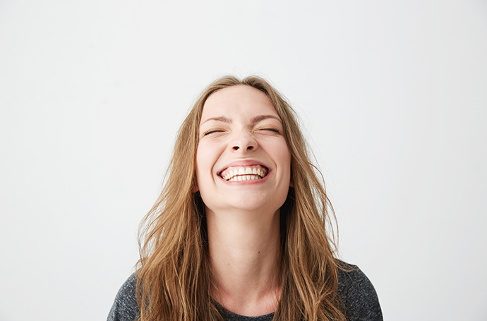 Portrait image of a woman with a big bright smile