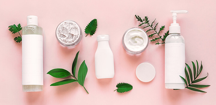 Array of skincare products photographed from above